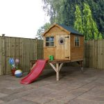 Childrens playhouse with tower and slide