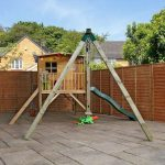 Childrens playhouse with tower, slide and play